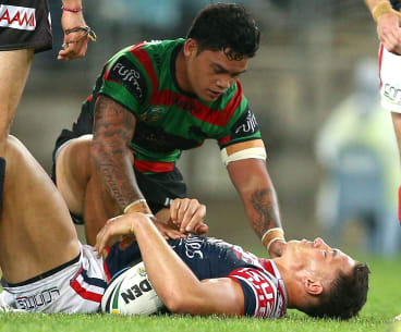Issac Luke with Sonny Bill Williams after the tackle that saw him suspended for the grand final.