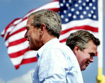 Changing of the guard: George W. Bush and his brother Jeb.