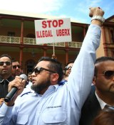 Taxi drivers protest against Uber at the NSW State Parliament in Sydney earlier this month.