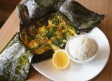 Lakes Entrance baby Silver Whiting, wrapped in banana leaves with Hoi An lemongrass, chilli and turmeric paste.