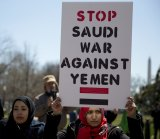 Protesters gather along Lafayette Square near the White House, Sunday, March 29, 2015, in Washington, to call for a halt to foreign intervention in Yemen.