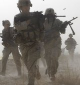 A U.S. soldier returns fire as others run for cover during a firefight with insurgents in the Badula Qulp area, West of Lashkar Gah  in Helmand province, southern Afghanistan,