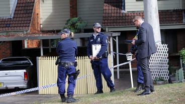 Police at a townhouse complex in Florida Street, Sylvania, where the body of a woman was found.