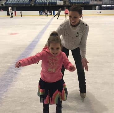 Former Olympian Joanne Carter on the ice with her cousin Layla.