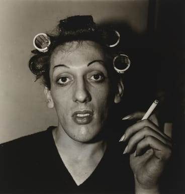 Diane Arbus, A young man in curlers at home on West 20th Street, NYC. 1966.