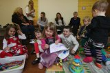 Parents and grandparents attend playgroup at St John's Anglican Church Hall.