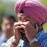 A man reacts outside the Sikh Temple of Wisconsin in Oak Creek, where a shooting took place in August 2012.