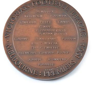 Ron Barassi's 1964 VFL premiership medal.  Estimate: $20,000-$30,000.