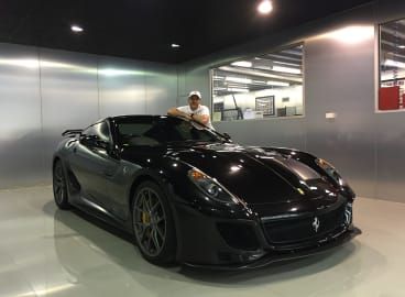Wheel collector: Melbourne Ferrari enthusiast Tony Defelice with one of his beloved Ferraris (a 599).