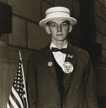 Diane Arbus, Boy with a straw hat waiting to march in a pro-war parade, NYC, 1967.