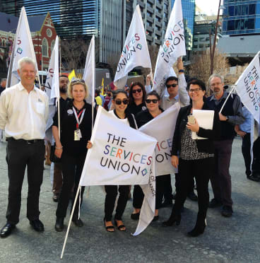 Members of the Queensland Services Union on strike on Wednesday.