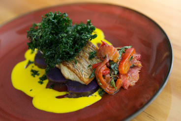 Fried barramundi with kale.