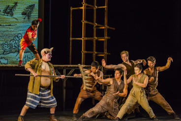 Darren Gilshenan as Pigsy, front left, with Aljin Abella as Monkey behind.