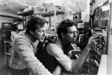 Max (James Woods), left, and Harlan (Peter Dvorsky) discovering the transmission signal of Videodrome.