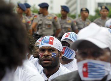 West Papuans activists watched by Indonesian police in Jakarta.