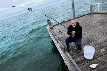 On the spot: Sam Psanis fishing on the Albert Park jetty.