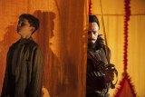 Levi Miller as Peter and Hugh Jackman as Blackbeard in the film <i>Pan</i>.