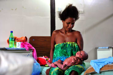 A new mother and her baby in Port Moresby.