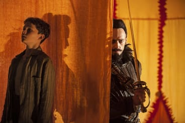 Levi Miller as Peter and Hugh Jackman as Blackbeard in the film <i>Pan</i>.
