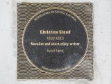 The plaque to honour writer Christina Stead on the pavement outside her former home.