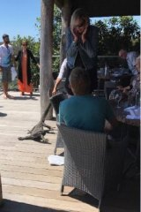 Diners at the restaurant were startled at the goanna's unwelcome arrival.