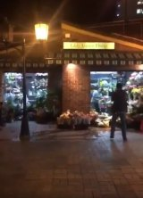 A screenshot from a video posted on social media shows the moment the man emerged from the florist.