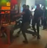 A screen shot from the video posted on Facebook that appears to show Thai guards at a nightclub beating up tourists.