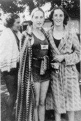 B Crawford, I Coeson, B Tippins from the Coburg Swim club who took part in a swimming race on the Yarra.