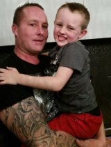 Damian with his son, Kynan, who is staying with family.