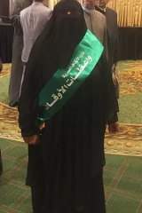 Female preacher Mona Salah wears a sash showing she has been approved by Egypt's Ministry for Religious Endowments.