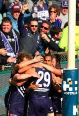 Fremantle players and fans celebrate as Matthew Pavlich boots his 700th goal