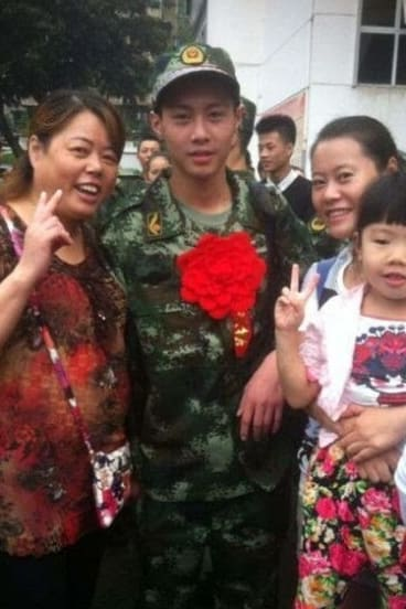 Firefighter Yuan Hai (centre) has reportedly died aged only 17.