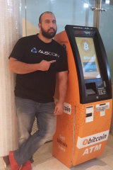Sam Karagiozis poses with one of his Auscoin ATMs