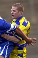 Jeromy Harris (right) playing for the Brisbane Strikers against Sydney Olympic at Suncorp Stadium in 2000.