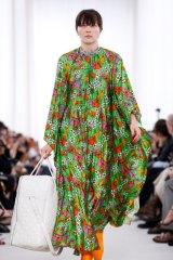 A model carries one of the 'blanket bags' in Demna Gvasalia's Balenciaga debut.