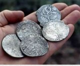 Silver coins recovered from a Dutch wreck off the WA coast.