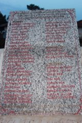The names of 33 who died from Ebola are honoured on a plaque in the centre of Bumpe.