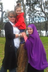 Sydney woman Karen Nettleton pictured with two of her grandchildren who are now trapped in Syria.