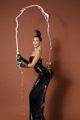 The champagne flows for Kim Kardashian in one of the shots by Jean-Paul Goude.