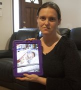 NSW mother Cherie holding a picture of her daugher, who can no longer get medical marijuana