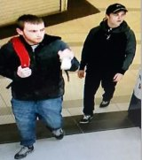 Police are searching for the two men after their alleged bungled burglary.
