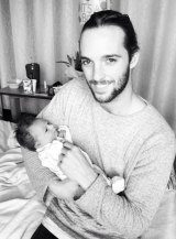 Kate's partner Aaron with baby Mason.