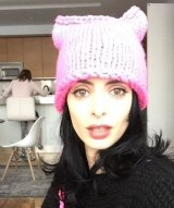 Actress Krysten Ritter shows off her very own pink pussy hat.