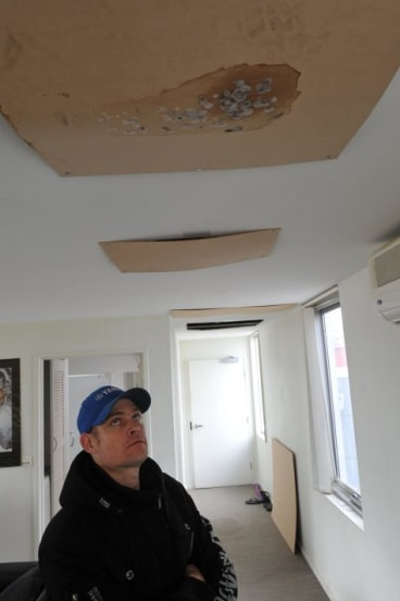 Holes in the ceiling and mould forces Gungahlin man Grant Seears out of freezing apartment