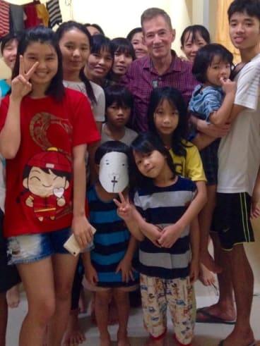 Retired US ambassador Grover Joseph Rees visits the Vietnamese families in detention.