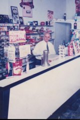 George behind The Rio counter. Once, the shop was a goldmine and people queued out the door for milkshakes.