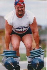 "Michael Sidonio competing in the ""farmer's walk""."