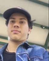 Jerome Forbes recorded 'racist' woman at a Brisbane bus stop.