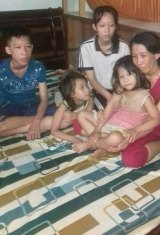 Tran Thi Thanh Loan and her four children. She is fighting a prison conviction. Her husband, Ho Trung Loi, has been jailed for two years.