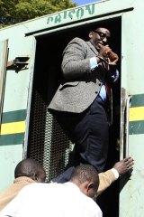 Edmund Kudzayi, editor of the state-run Sunday Mail newspaper, leaves Harare Magistrates Court on Saturday.